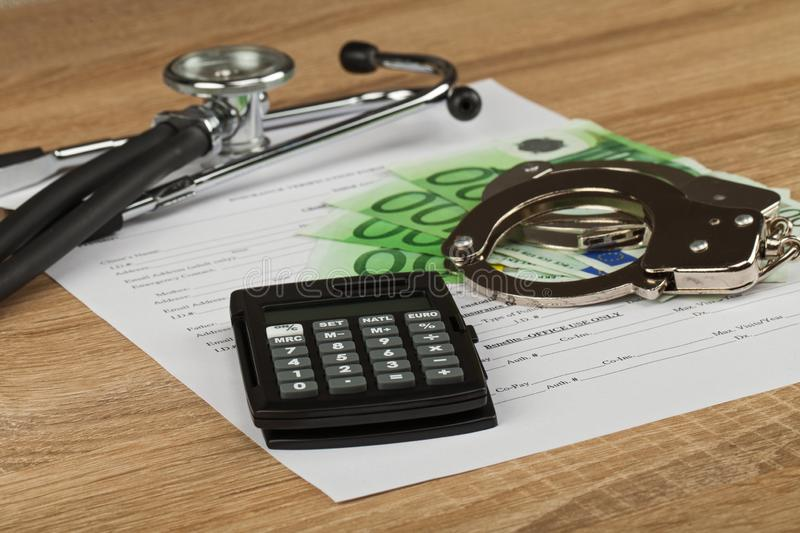 Expensive healthcare. Close up picture of medical insurance document, pills, calculator and money - Healthcare costs stock image