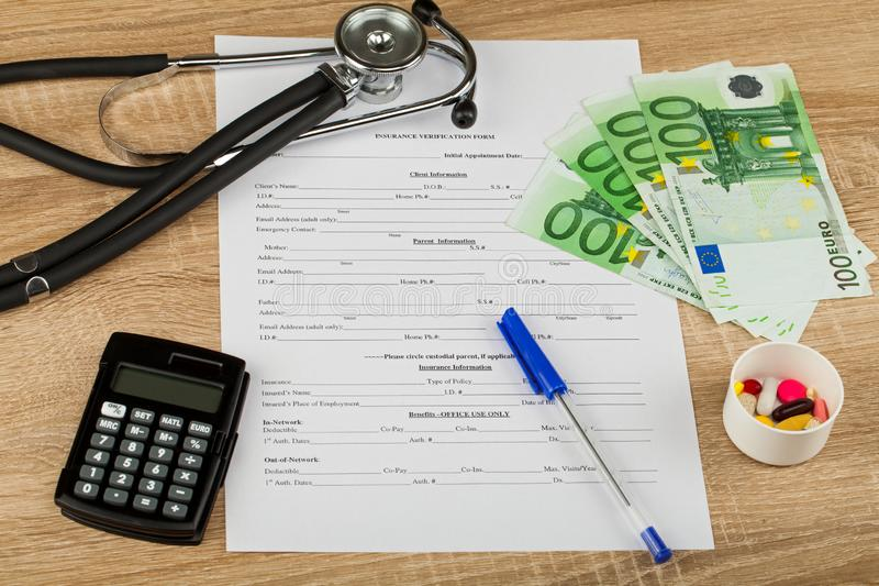 Expensive healthcare. Close up picture of medical insurance document, pills, calculator and money - Healthcare costs royalty free stock images