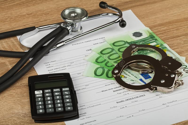 Expensive healthcare. Close up picture of medical insurance document, pills, calculator and money - Healthcare costs royalty free stock image