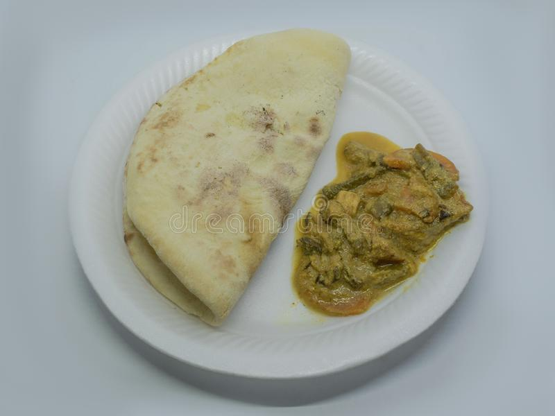 Close up picture of mix vegetable curry server with tandoori roti stock photo