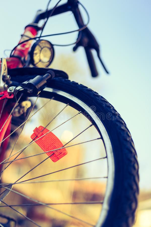 Close up of mountain bike tyres outside, summer day, city mobility. Bike in blurry background. Close up picture of a mountain bike tyre, summer day. Bike in the royalty free stock photos
