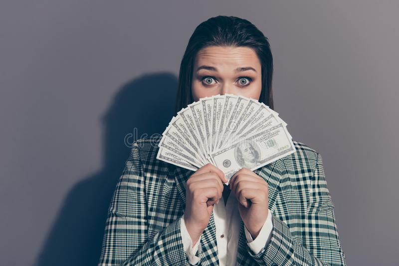 Close up picture photo portrait of amazed staring watching you she her lady showing earnings income in hands isolated stock photo