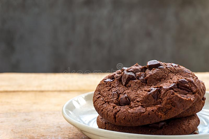 Close up picture of pile chocolate cookies in white plate stock photo