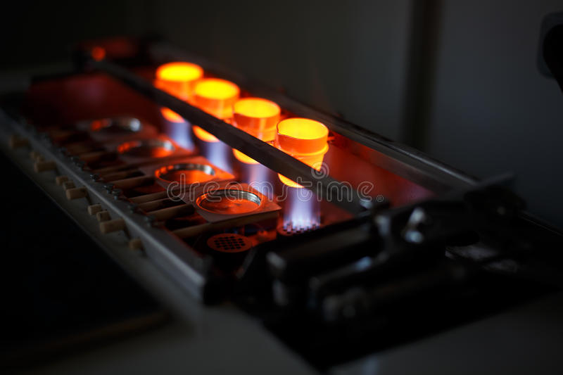 Liquid steel melting on a furnace on a dark background. Technology for roasting metal. Industrial metallurgy equipment. stock photo