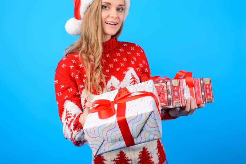 Close up picture of smiling pretty woman in knitted warm sweater royalty free stock photos
