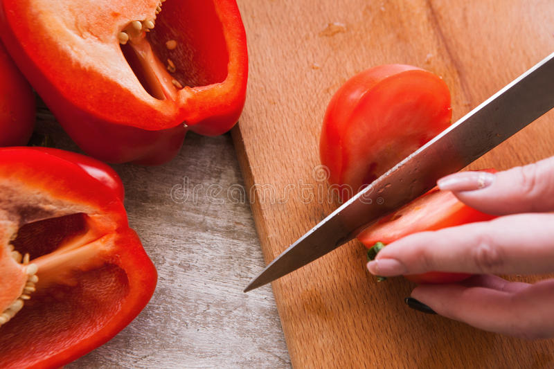 Close up picture of tomatoes and pepper cutting royalty free stock photography