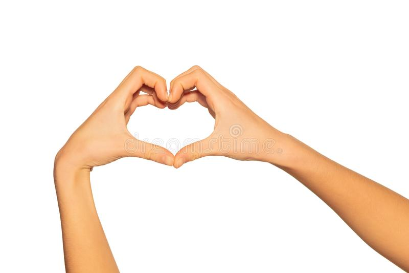 Heart shaped hands as gesture of love and romance stock photos