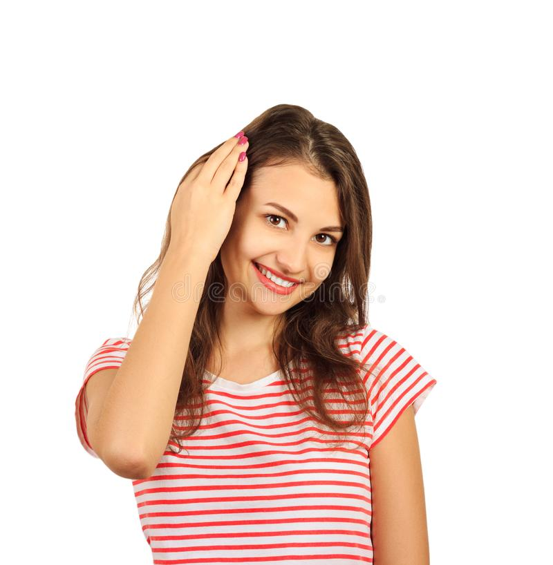 Close up picture of a young beautiful woman fixing her hair while looking at the camera. emotional girl isolated on white backgrou royalty free stock image