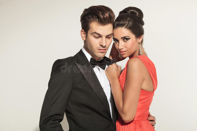 Close up picture of a young elegant couple embracing stock photography