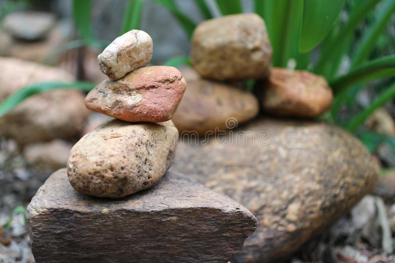 Close-up pictures of rocks stacked together, natural background in the forest. Outdoor stock photography