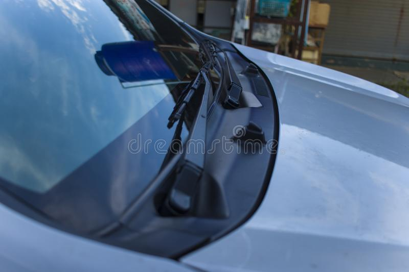Close-up pictures of windshields and wipers of car royalty free stock image
