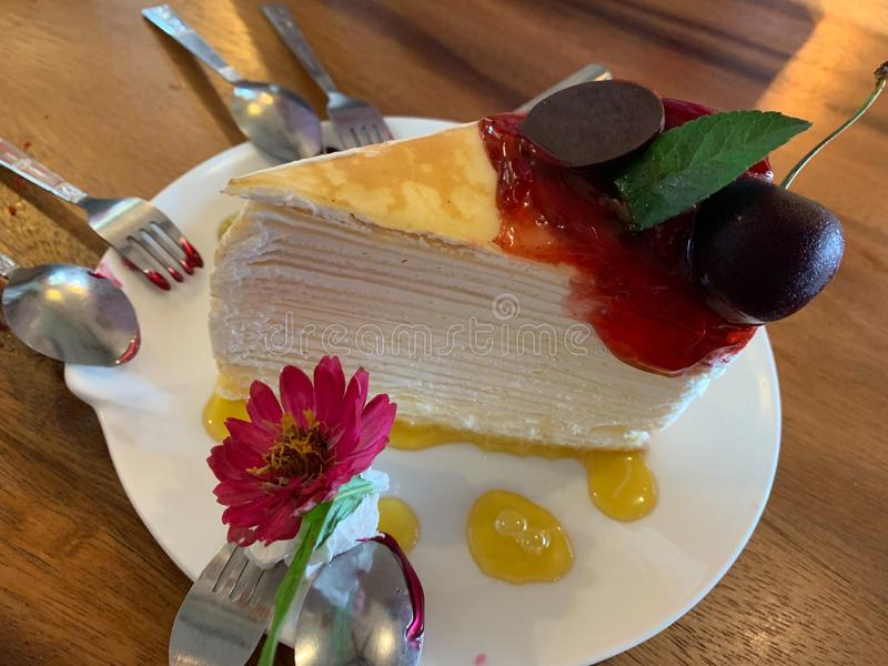Close up piece of homemade Crepe cake in white plate royalty free stock image