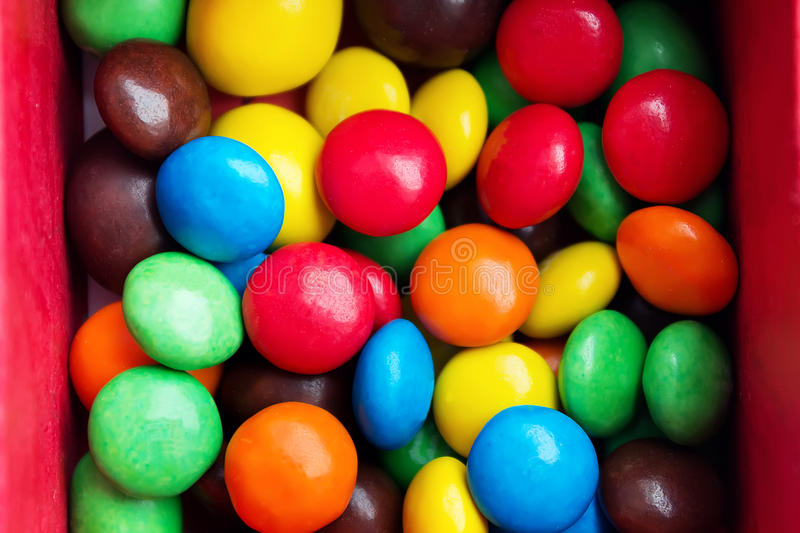 Close up of a pile of colorful chocolate coated candy.  stock images