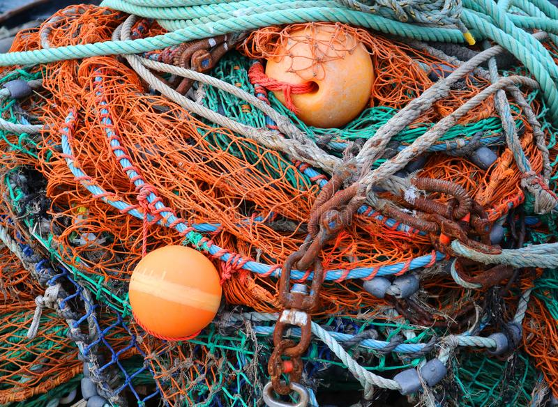 Close Up Pile of Colorful Fish Nets and Buoys stock images