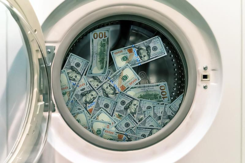 Close-up Of Pile Of Dirty Money Placed In Washing Machine royalty free stock image