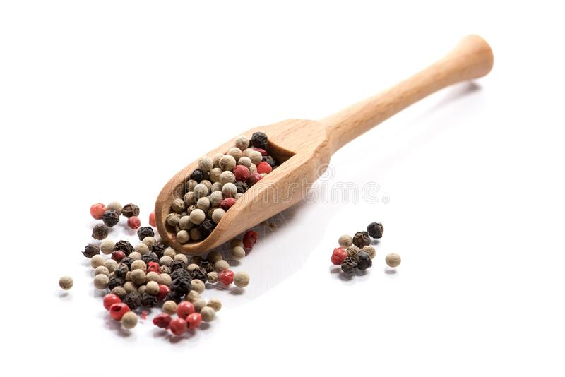 Close-up of pile of pepper seeds mix spice in a wooden spoon on royalty free stock images