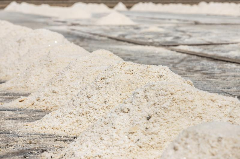 Close up piles of raw white sea salt in the salt farm stock image