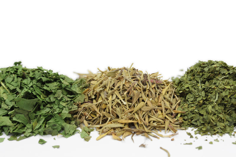 Close up on piles of various herbs stock images