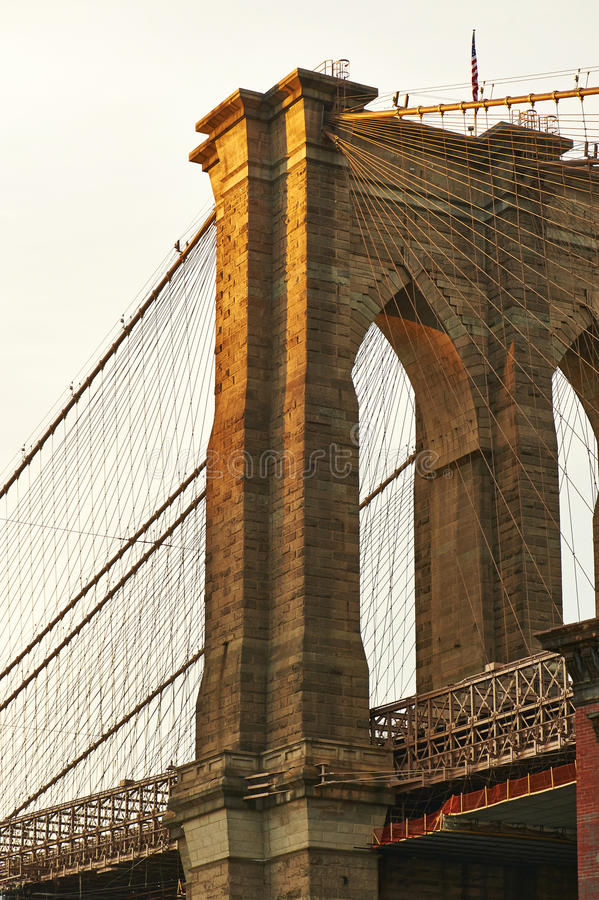 Close up of a pillar of the Brooklyn bridge at sunset royalty free stock images