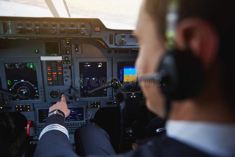 Aviator hand working with aircraft appliance royalty free stock photo