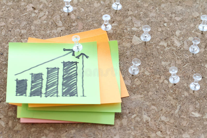 Close up of pin and hand drawn business strategy graph chart royalty free stock photo