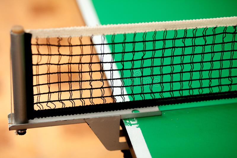 Close up ping pong net and line - green table stock photos