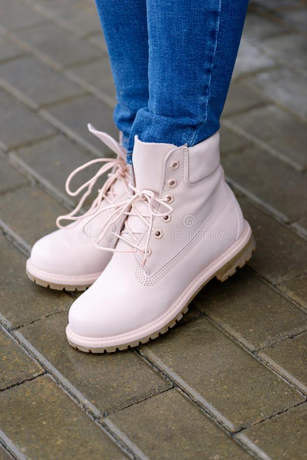 Close-up pink boots on woman`s legs stock photography