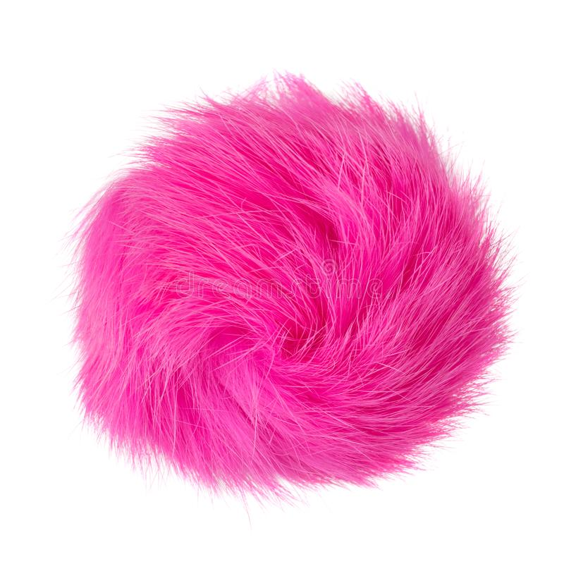 Close up of pink rabbit fur pompom isolated on white background stock images