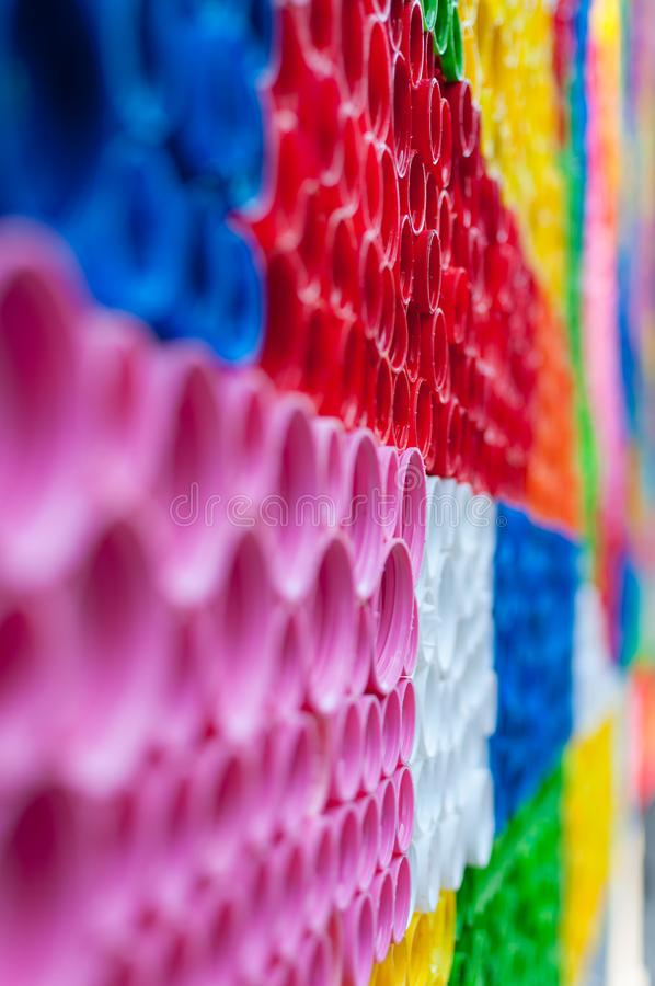 Close-up on plastic bottle caps. Art made of multi colored bottle caps royalty free stock photography