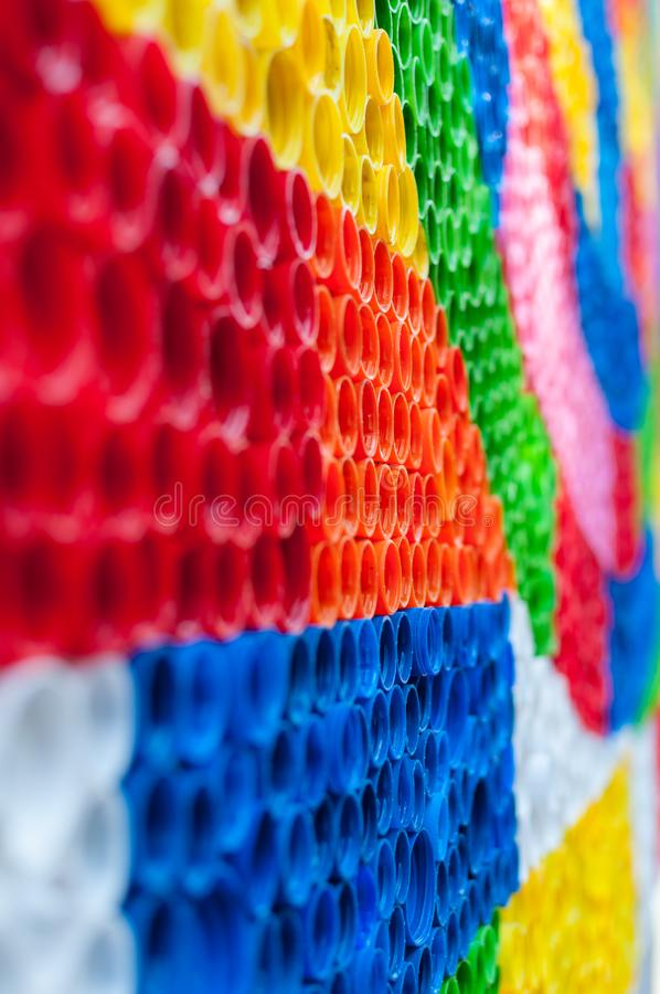 Close-up on plastic bottle caps. Art made of multi colored bottle caps stock image