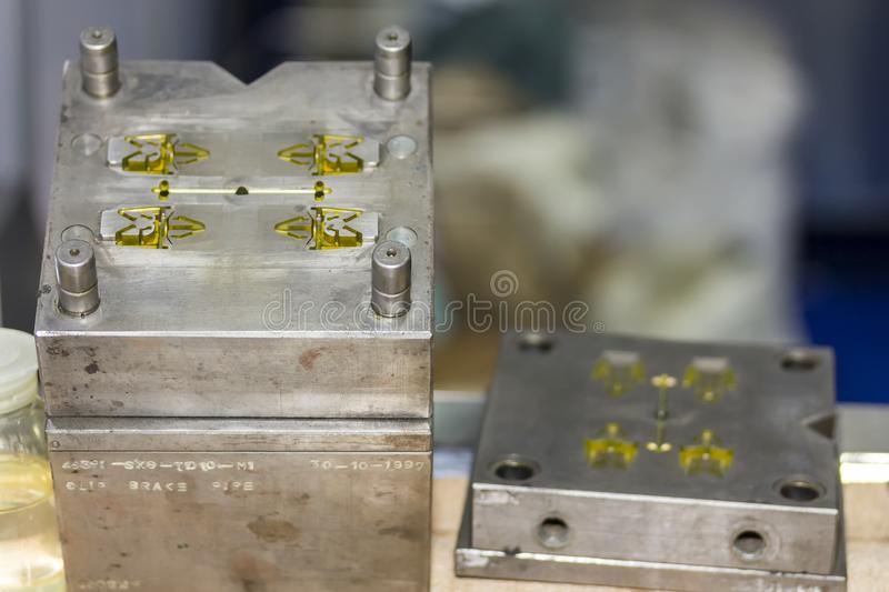 Close up plastic mold bottle blowing for mass production manufacturing process for industrial work.  royalty free stock images
