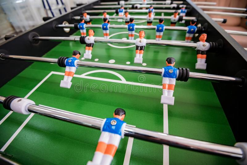 Close up plastic table football game at entertainment center stock image