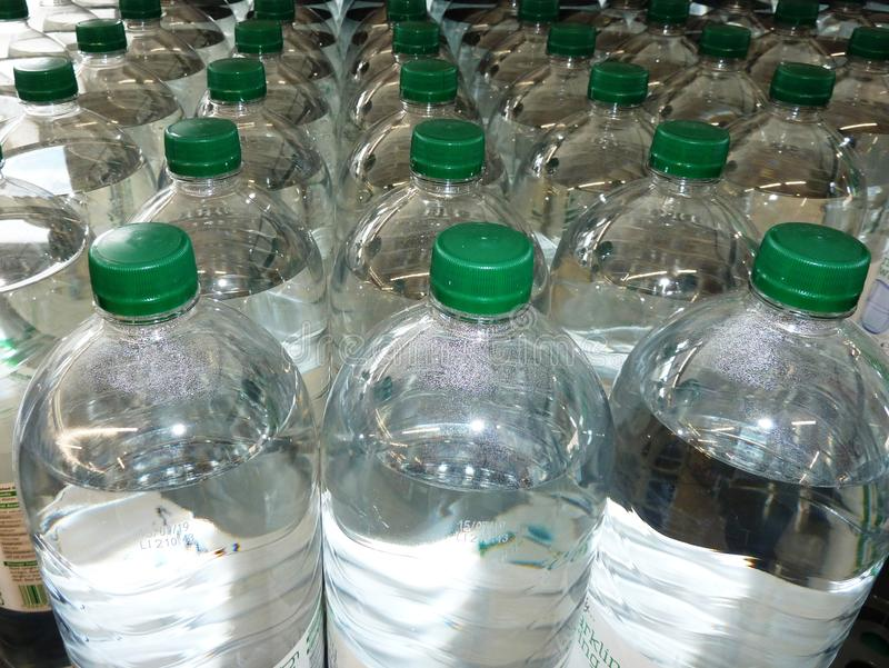 Plastic bottles of water stock image