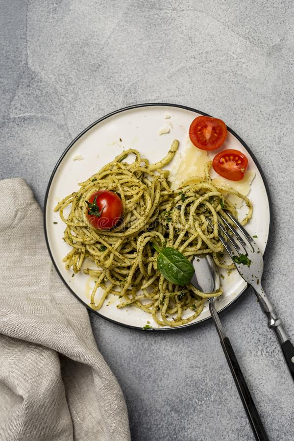 Close up plate with spaghetti and pesto sauce stock photography