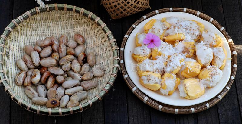 Close up plate of sticky jackfruit and seed basket for breakfast stock photos