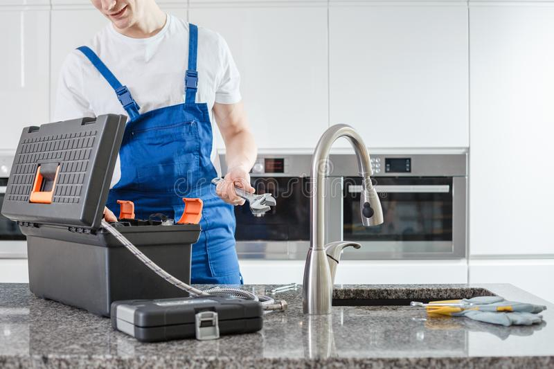 Toolbox and gloves on countertop stock images