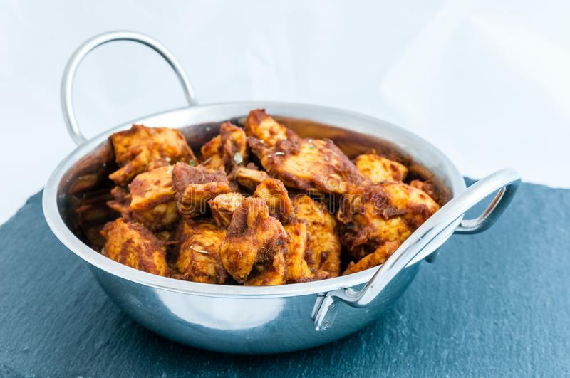 Chicken Rendang curry. Close up of the popular Malaysian dish, rendang chicken stock photo