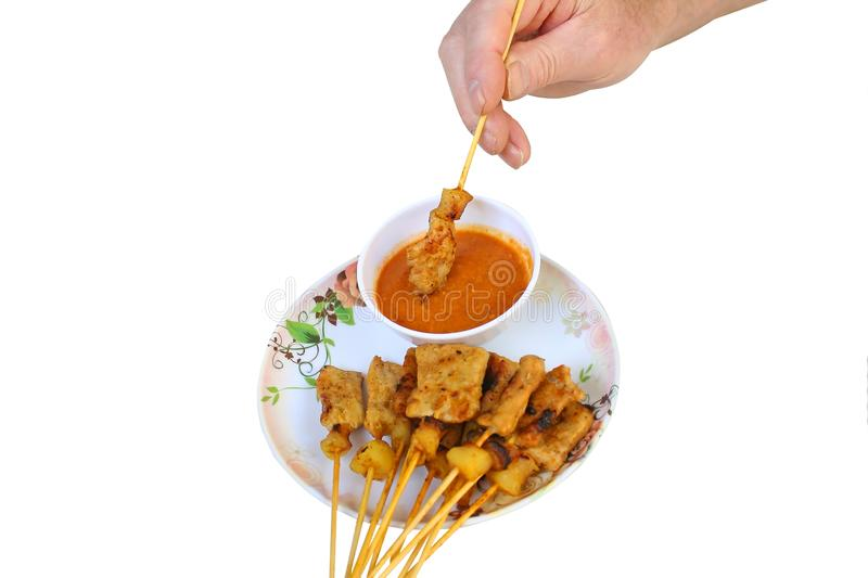 Pork Satay with Peanut Sauce isolated on white background royalty free stock photo