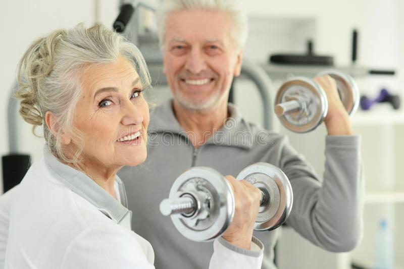 Close up portrait of active smiling senior couple exercising royalty free stock photography