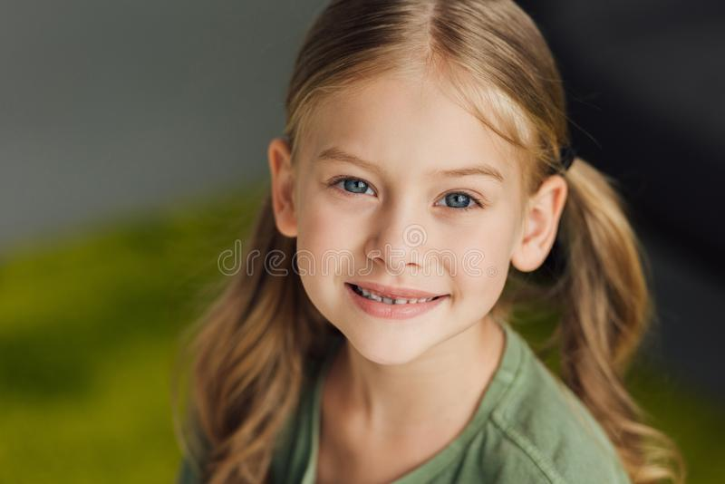 Close-up portrait of adorable little child. Smiling at camera stock image