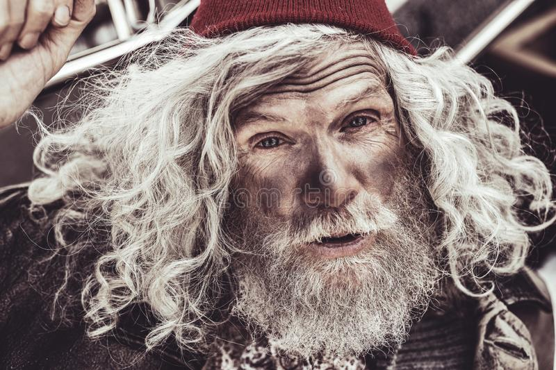 Close up portrait of almsman whose greeting the passerby. stock photos