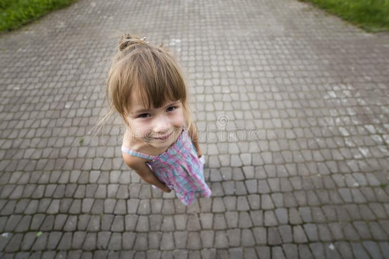 Close-up portrait, angled view from above of little blond pale u royalty free stock images