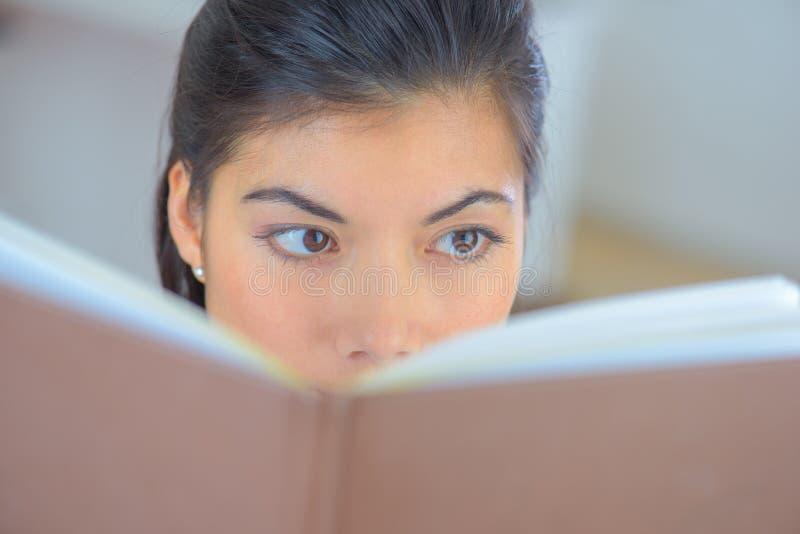 Close up portrait asian woman reading book stock photos