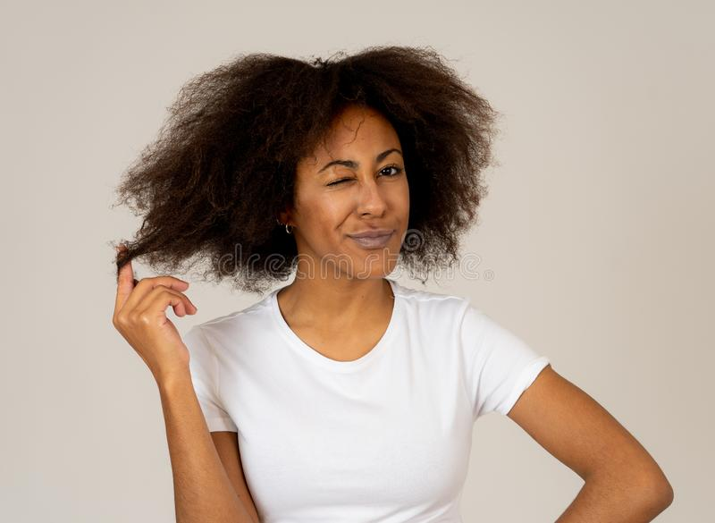 Young attractive cheerful african american woman smiling happy. Human expressions and emotions royalty free stock photography