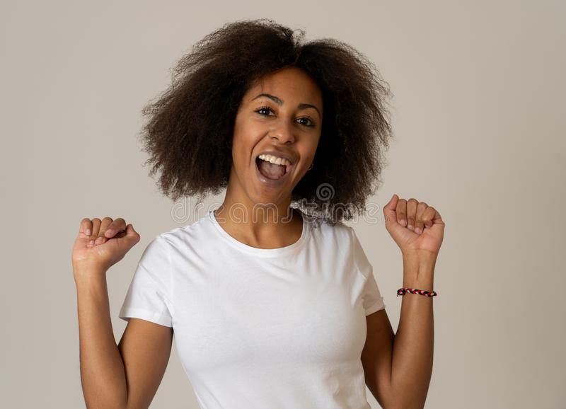 Young attractive cheerful african american woman smiling happy. Human expressions and emotions royalty free stock photo