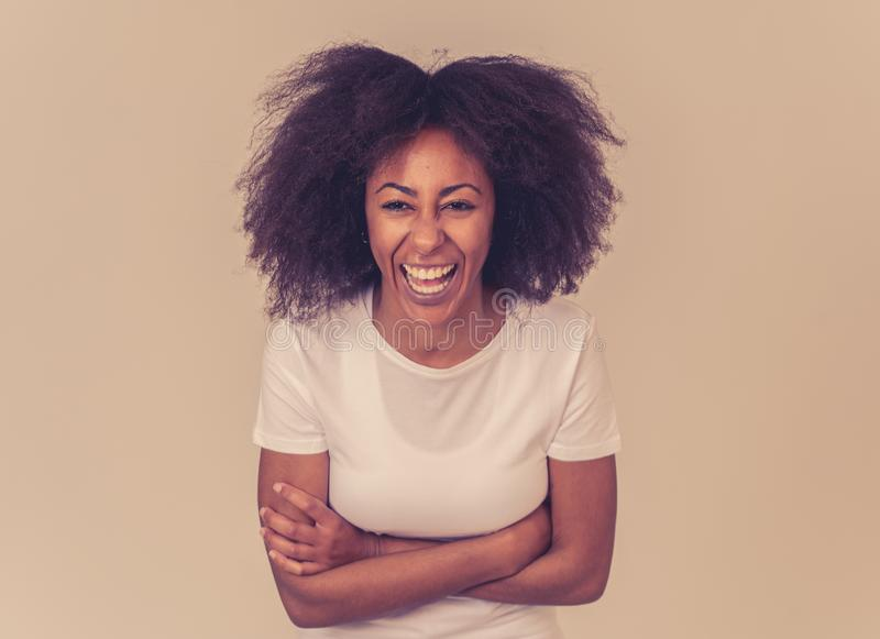 Young attractive cheerful african american woman smiling happy. Human expressions and emotions royalty free stock image