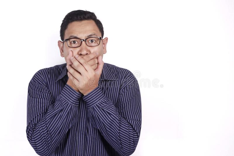Asian Man Shocked and Closing his Mouth royalty free stock images