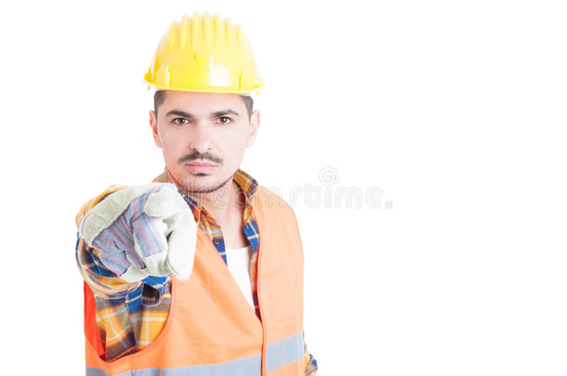 Close up portrait of attractive engineer pointing at you. With a serious expression on his face with copypaste isolated on white stock images