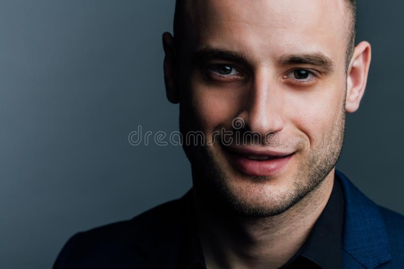 Close-up portrait of a attractive handsome man. Good nice guy looks at the frame. royalty free stock photography