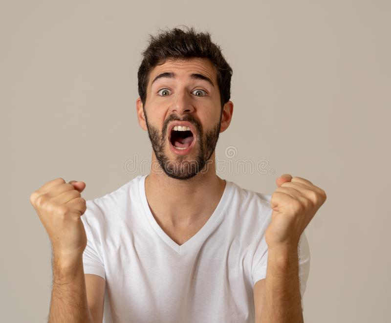 Close up portrait of attractive man surprised celebrating victory goal wining team or lottery. Portrait of Amazed excited funny Man achieving his goal or wining royalty free stock images